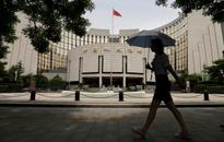 China central bank says debt, financial risks under control