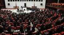 Turkish parliament, amid brawls, backs new constitution and paves way for referendum