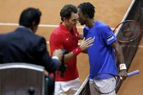 Beaten Federer consoled by shaking