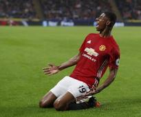 Late show helps Manchester United join Chelsea on top