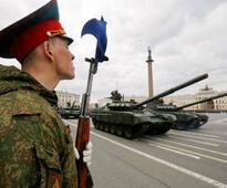 Russia 'gunning' for tourists with MiGs, tanks, AK-56s