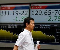 Asia dips as weak results halt bull run on Wall Street, yen holds gains
