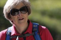 PM May dressed for action on Swiss Alps trek with husband