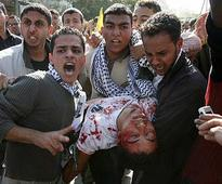 At least 6 dead in clashes at Fatah rally in