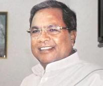 Don't lecture on development: Karnataka CM Siddaramaiah to Adityanath