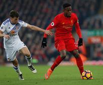 Striker Origi wants Reds to keep pressure on Chelsea