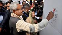 Speaking in code? Bihar CM Nitish Kumar paints a lotus and sparks furore