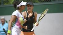 French Open: Sania-Hingis battle into second round