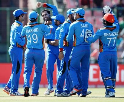 WORLD T20 PHOTOS: England survive collapse to sink Afghanistan