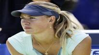 Sharapova re-dresses for success to reach fourth round