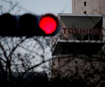 Most Japan firms favour cautious approach to any Toshiba delisting: poll