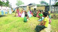 At camps in Kaziranga, they flaunt land pattas
