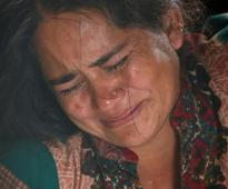 Tearful Nepal relatives of Kabul attack victims receive bodies