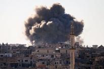 Fresh raids pound Syrias rebel Douma after talks falter
