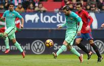Messi double lifts Barca