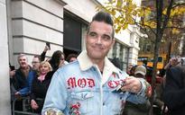 Robbie Williams reveals his secret health battle as brain abnormalities left him in intensive care