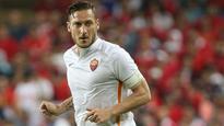 Digne hails humble Totti
