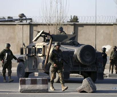 Taliban kill dozens at army HQ in northern Afghanistan