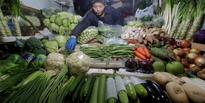 China vows to contain corporate debt levels as inflation heats up