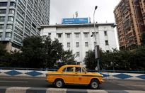 Reliance Communications' shares and bonds plunge as losses and debt woes mount