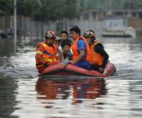 China floods: Over 250 feared dead in heavy rains and floods