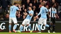 Aguero hits 100, but Newcastle earn a point against Man City