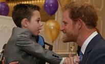 Prince Harry breaks royal protocol by hugging terminally ill fan