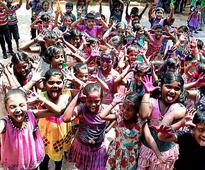 Schoolchildren celebrate Holi