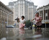 Over 225 killed or missing, thousands evacuated as heavy floods lash China