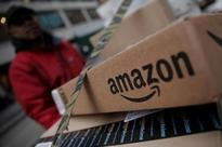 Amazon is building global delivery business to take on Alibaba