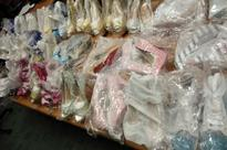 Two women nabbed for sale of counterfeit luxury goods at Far East Plaza