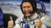 Astronaut returns to earth