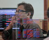 Sensex, Nifty surrender record gains on GST blues, mixed global cues