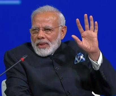 PM takes jibe at Pak in Russia, says some countries are giving arms to terrorists