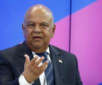 South Africa's Gordhan alleges campaign by Guptas against Treasury