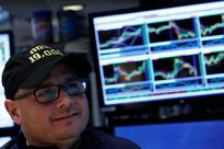 Dow, S&P 500 hit record highs; dollar loses steam