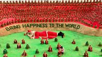 Odisha: Sand artist Sudarsan Pattnaik creates 1,000 Santa Claus sculptures on Puri beach