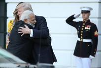Modi embraces the world with his 'bear hug'