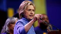 Clinton blasts Trump for cheering housing bubble burst
