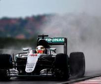 Hungarian GP: Rosberg edges out Hamilton for pole