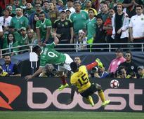 Chicharito powers Mexico past Jamaica 2-0, into quarterfinal