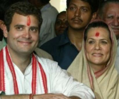 We ALL stand by Dr Singh, says Sonia, Rahul