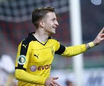 Reus goals crucial as Dortmund hunt leaders Bayern