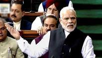 Opposition turns the heat on Modi over raincoat remark
