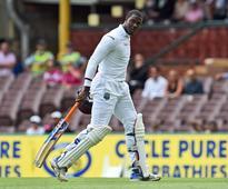 West Indies 248-7 at close in rain-hit Sydney ... West Indies batsmen Denesh Ramdin (L) and Carlos Brathwaite (...