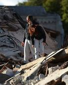 Italy quake toll climbs: at least 18 dead