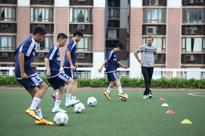 David Beckham goes undercover to surprise young footballers