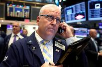 Wall Street boosted by rise in oil, Wal-Mart
