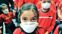 NCR schools open in a haze, parents worried