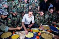 President al-Assad partakes in Iftar with heroes of the army in Marj al-Sultan Airport